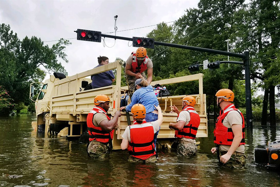 Hurricane Harvey victims getting rescued by National Guard